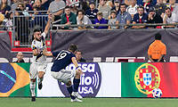 Foxborough, Massachusetts - July 14, 2018: In a Major League Soccer (MLS) match, Los Angeles Galaxy (white) defeated New England Revolution (blue/white), 3-2, at Gillette Stadium. Yellow card foul by Antonio Milnar Delamea.