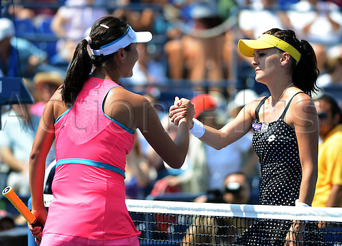 27.08.2014. Flushing Meadows, NY, USA. Day 3 of the US Open championships. R-L, Agnieszka Radwanska (POL)shakes hands with Shuai Peng (CHN)