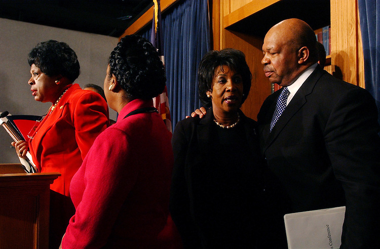 cbc6/121002 -- At right, Rep. Elijah Cummings, D-Md., incoming Chairman of the Congressional Black Caucus, has a word with Rep. Maxine Waters, D-Calif., during a  a news conference on the CBC's new leadership, Tuesday.....