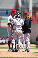 Richmond Flying Squirrels pitching coach Steve Kline (right) talks with pitcher Stephen Johnson (19) and catcher Eliezer Zambrano (2) during a game against the Erie Seawolves on May 20, 2015 at Jerry Uht Park in Erie, Pennsylvania.  Erie defeated Richmond 5-2.  (Mike Janes/Four Seam Images)