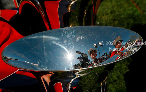 The image of some members of the Marine Band and some photographers is reflected in a tuba during the Arrival Ceremony hosted by the president and Mrs Bush for Pope Benedict XVI, in the South Lawn of the  White House, Washington DC, April 16, 2008.