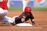 Batavia Muckdogs outfielder Alex Fernandez (46) dives back to first on a pickoff attempt during a game against the Auburn Doubledays on September 7, 2015 at Falcon Park in Auburn, New York.  Auburn defeated Batavia 11-10 in ten innings.  (Mike Janes/Four Seam Images)
