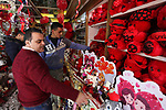 Palestinian vendors display flowers, red teddy bears, red ballons and pillows on Valentine's day, in Gaza city on February 14, 2019. Valentine's Day is increasingly popular in the region as people have taken up the custom of giving flowers, cards, chocolates and gifts to sweethearts to celebrate the occasion. Photo by Mahmoud Ajjour