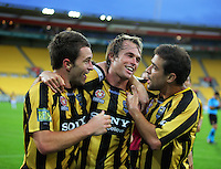 Phoenix's Tim Brown (left) and Daniel Cortes congratulate Dylan Macallister on his goal. A-League football - Wellington Phoenix v Newcastle Jets at Westpac Stadium, Wellington on Saturday, 18 December 2010. Photo: Dave Lintott / lintottphoto.co.nz