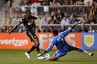 Danny Mwanga (10) of the Philadelphia Union gets past Los Angeles Galaxy goalkeeper Donovan Ricketts (1) to score the game winning goal. The Philadelphia Union  and the Los Angeles Galaxy played to a 1-1 tie during a Major League Soccer (MLS) match at PPL Park in Chester, PA, on May 11, 2011.