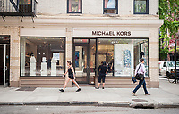 The Michael Kors store on trendy Bleecker Street in New York on Thursday, June 1, 2017. Following a disastrous fourth-quarter Michael Kors announced that it would be closing between 100 and 125 full-price stores over two years. (© Richard B. Levine)
