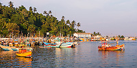 Panoramic photo of old commercial fishing boats in Mirissa Harbour, South Coast of Sri Lanka, Asia. This is a panoramic photo of old commercial fishing boats in Mirissa Harbour, South Coast of Sri Lanka, Asia.
