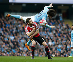 David Silva of Manchester City tackles Juan Mata of Manchester United during the Barclays Premier League match at The Etihad Stadium. Photo credit should read: Simon Bellis/Sportimage