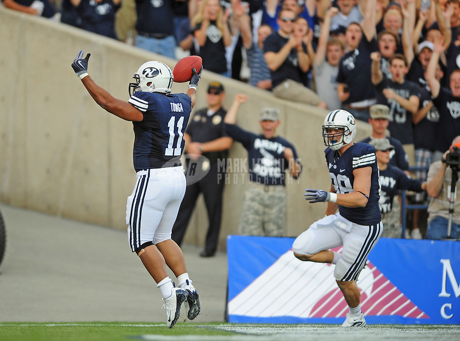 Sept. 19, 2009; Provo, UT, USA; BYU Cougars running back (11) Manase Tonga celebrates his second quarter touchdown against the Florida State Seminoles at LaVell Edwards Stadium. Mandatory Credit: Mark J. Rebilas-
