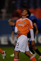 Houston Dynamo forward Brain Ching looks to the sky in frustration after narrowly missing a second goal on the night. The Houston Dynamo beat the Colorado Rapids 1-0 on a goal by Brian Ching, April 29, 2006, at Invesco Field at Mile High Stadium in Denver, Colorado.