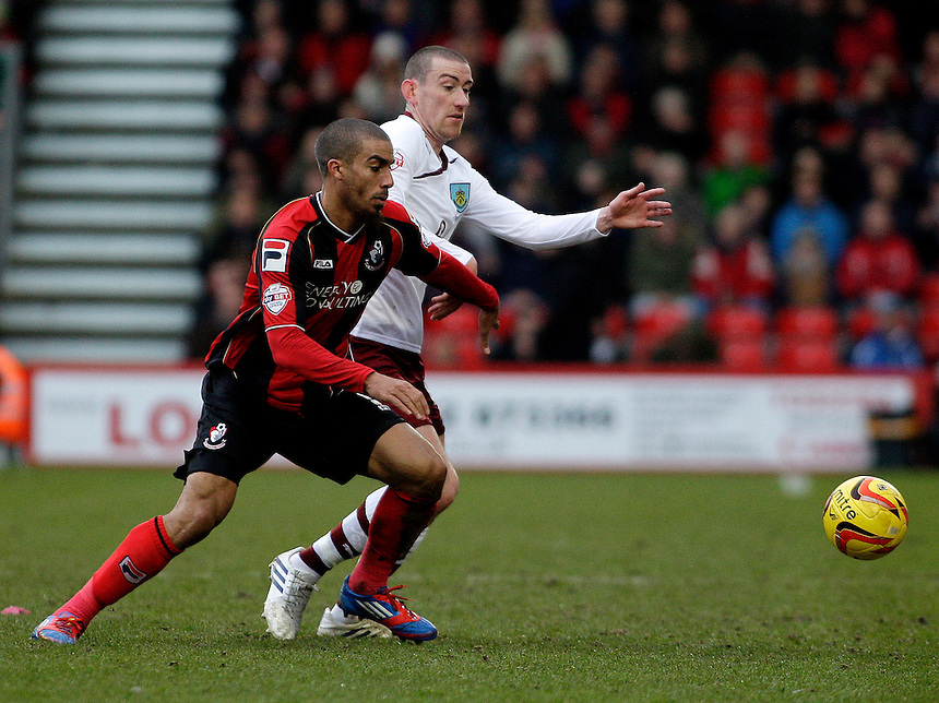 Burnley's David Jones battles for possession with Bournemouth's Lewis Grabban.<br /> <br /> Photo by James Marsh/CameraSport<br /> <br /> Football - The Football League Sky Bet Championship - Bournemouth v Burnley - Saturday 15th February 2014 - Goldsands Stadium - Bournemouth<br /> <br /> &copy; CameraSport - 43 Linden Ave. Countesthorpe. Leicester. England. LE8 5PG - Tel: +44 (0) 116 277 4147 - admin@camerasport.com - www.camerasport.com