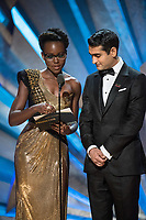 Lupita Nyong'o and Kumail Nanjiani present the Oscar&reg; for achievement in production design during the live ABC Telecast of The 90th Oscars&reg; at the Dolby&reg; Theatre in Hollywood, CA on Sunday, March 4, 2018.<br /> *Editorial Use Only*<br /> CAP/PLF/AMPAS<br /> Supplied by Capital Pictures