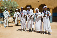 Merzouga, Morocco.  Gnaoua Musicians Playing Krakeb and Drums, Performing Traditional Song and Dance.