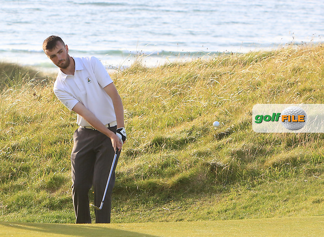 Senan Carroll (Ballybunion) on the 15th green during the Munster Final of the AIG Senior Cup at Tralee Golf Club, Tralee, Co Kerry. 12/08/2017<br /> <br /> Picture: Golffile | Thos Caffrey<br /> <br /> All photo usage must carry mandatory copyright credit     (&copy; Golffile | Thos Caffrey)