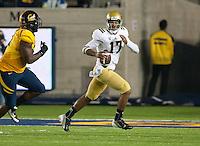 October 6th, 2012: UCLA's Brett Hundley scrambles away from California's defense during a game against California at Memorial Stadium, Berkeley, Ca    California defeated UCLA 43 - 17