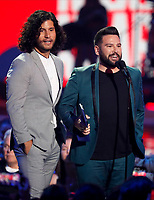 NASHVILLE, TN - JUNE 5: (L-R) Dan Smyers and Shay Mooney of musical duo Dan + Shay accept an award on the 2019 CMT Music Awards at Bridgestone Arena on June 5, 2019 in Nashville, Tennessee. (Photo by Frederick Breedon/PictureGroup)