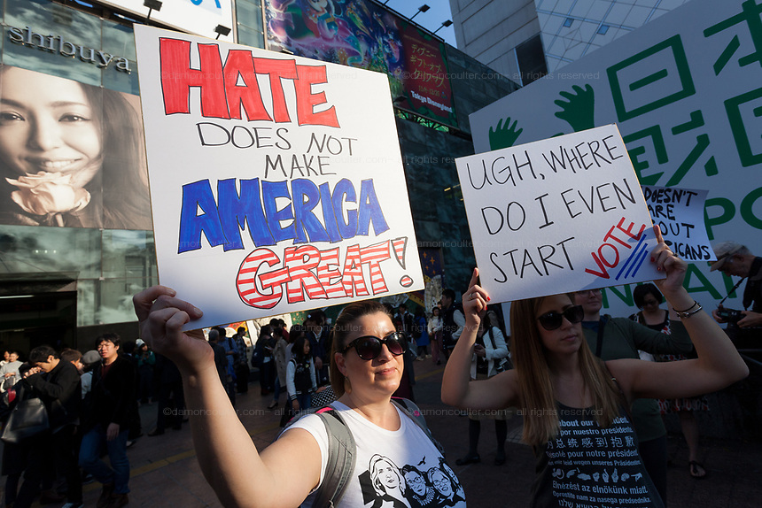 "A woman holds a sign that reads, Hate does not make America Great"" at the Vote Out the Scandal rally at Hachiko Square, Shibuya, Tokyo, Japan. Sunday November 5th 2017. Timed to coincide with President Trumps visit to Japan, About 120 Americans living in Japan and some local Japanese  protested together from 2pm to 4pm to encourage US citizens to register to vote in future elections and call on the US government to honour it responsibilities to the American people,."