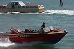 Fire brigade/ Civil guards speed boat on the Venice lagoon, Venice, Italy, May 2007.