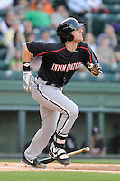 Infielder Danny Hayes (32) of the Kannapolis Intimidators bats in a game against the Greenville Drive on Friday, April 11, 2014, at Fluor Field at the West End in Greenville, South Carolina. Greenville won, 13-2. (Tom Priddy/Four Seam Images)