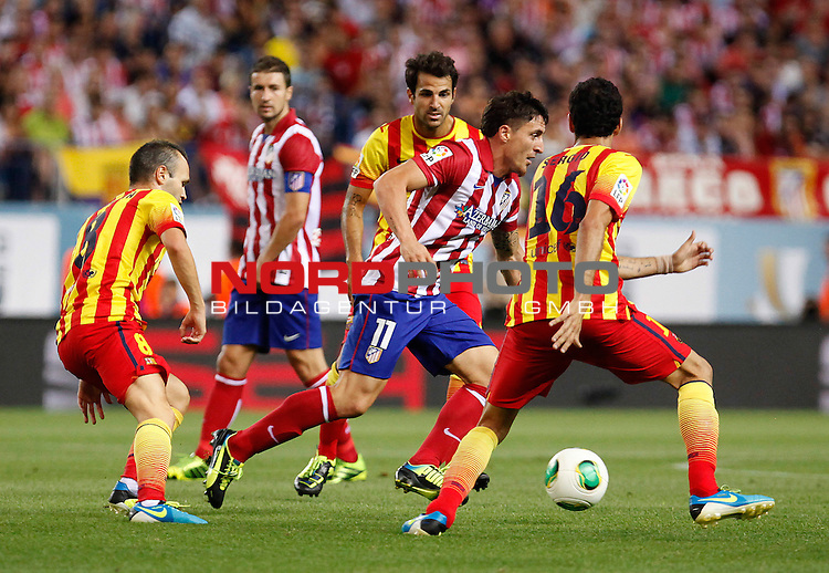 Atletico de Madrid's Cristian Cebolla Rodriguez (c) and FC Barcelona's Andres Iniesta (l), Cesc Fabregas (b) and Sergio Busquets during Supercup of Spain 1st match.August 21,2013. Foto © nph / Victor Blanco)