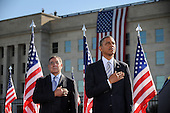 United States President Barack Obama flanked by U.S. Secretary of Defense Leon Panetta commemorates the 11th anniversary of the 9-11 attacks during a ceremony at the Pentagon, on September, 11, 2012 in Arlington, Virginia..Credit: Olivier Douliery / Pool via CNP