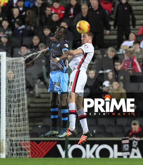 Darren Potter of MK Dons wins the ball in mid airduring the Sky Bet Championship match between MK Dons and Sheff Wednesday at stadium:mk, Milton Keynes, England on 15 December 2015. Photo by Liam Smith.