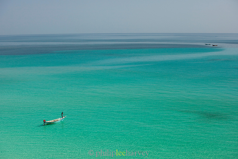 Fisherman in the shallows near Hadibu, Socotra, Yemen