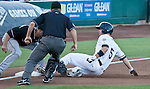 Reno Aces Cole Gillespie is called out at third during their game agianst Albuquerque Isotopes on Friday night August 10, 2012 at Aces Ballpark in Reno NV.