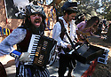 Reece Miller plays accordian and belts out a Celtic tune with Dread Crew of Oddwood  during 10th annual Fall Renaissance Faire at Felicita Park in Escondido.