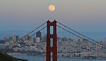 The June full moon rises over the Golden Gate Bridge as seen from the Marin Headlands on June 2, 2012..