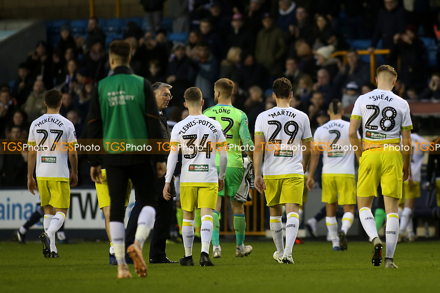 Despair for the Hull City players as they walk off the pitch at the final whistle after losing 2-1 having conceded two late goals during Millwall vs Hull City, Emirates FA Cup Football at The Den on 6th January 2019