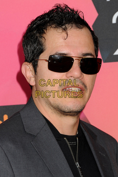 JOHN LEGUIZAMO.at the 23rd Annual Nickelodeon Kids' Choice Awards 2010 held at Pauley Pavilion in Westwood, California, USA, March 27th 2010 .arrivals kids portrait headshot black sunglasses beard facial hair mouth open moustache musatche grey gray zip .CAP/ADM/BP.©Byron Purvis/Admedia/Capital Pictures