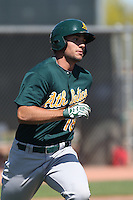Matt Olson #18 of the Oakland Athletics runs the bases during a Minor League Spring Training Game against the Los Angeles Angels at the Los Angeles Angels Spring Training Complex on March 17, 2014 in Tempe, Arizona. (Larry Goren/Four Seam Images)