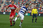 Brian McBride takes one on the shin from Drew Moor
