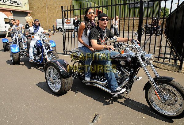 SHAUN WRIGHT PHILLIPS, SU-ELISE NASH & WAYNE BRIDGE .At the Harley Davidson Celebrity bike ride, Warr's Harley Davidson, Kings Road, London, England, UK, .9th August 2009..full length black Christian Audigier  t-shirt jeans sitting on motorbike motor backwards cap hat sunglasses riding on the back motorcycle shades denim .CAP/CAN.©Can Nguyen/Capital Pictures
