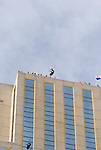 Jesse Hall launches over the rail of the Silver Legacy during an urban Ski-BASE jump off the roof of the Silver Legacy hotel casino in downtown Reno, Nev., Saturday Nov. 17, 2007. The stunt was to promote the local premier of the 2007 Warren Miller ski movie Playground and to raise money for the Make-a-Wish foundation, which helps make wishes come true for seriously ill children.