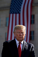United States President Donald J. Trump pauses during a ceremony to commemorate the September 11, 2001 terrorist attacks, at the Pentagon in Washington, D.C., U.S., on Monday, Sept. 11, 2017. Trump is presiding over his first 9/11 commemoration on the 16th anniversary of the terrorist attacks that killed nearly 3,000 people when hijackers flew commercial airplanes into New York's World Trade Center, the Pentagon and a field near Shanksville, Pennsylvania. <br /> CAP/MPI/CNP/RS<br /> &copy;RS/CNP/MPI/Capital Pictures