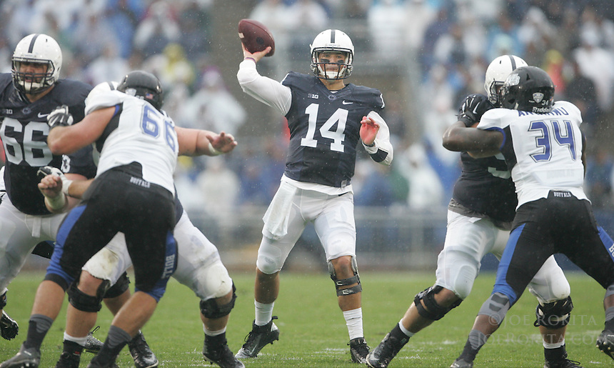 State College, PA - 09/12/2015:  Penn State QB Christian Hackenberg (14) throws the ball during the game. Hackenberg was 14 for 27 passing for 128 yards and 1 touchdown. Penn State defeated Buffalo by a score of 27-14 at rainy Beaver Stadium in University Park, PA.<br /> <br /> Photos by Joe Rokita / JoeRokita.com