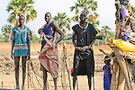 "A young Dinka man in a cattle camp in Eastern Rumbek, South Sudan keeps his AK-47 close..This photo depicts the commonality of weaponry, even in remote cattle camps like this one. South Sudan has endured generations of civil war - a Comprehensive Peace Agrement between the Government of Sudan in Khartoum and the Sudan People's Liberation Movement (SPLM) was signed only in January 2005. ..When I lived in South Sudan in 2005-2006, ordinary people - men, women, and children - carrying their AK-47s in the market or on the main road through town was a common sight. Given this context, gunfights between men who had been drinking - or among families during civil disputes - were also ""normal."" Particularly in ethnic Dinka areas, where Dinka sub-tribes traditionally clash, carrying AK-47s and other guns is a simple means of protection."