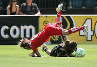Sonia Bompastor falls over Tina DiMartino. FC Gold Pride defeated Washington Freedom 3-2 at Buck Shaw Stadium in Santa Clara, California on August 1, 2009.