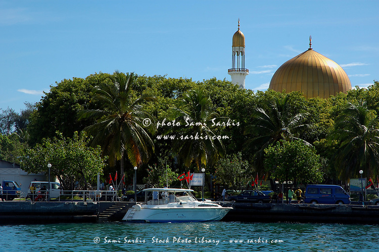 Dome of Grand Friday Mosque peaks through palm trees in Male, North Male Atoll, Maldives.