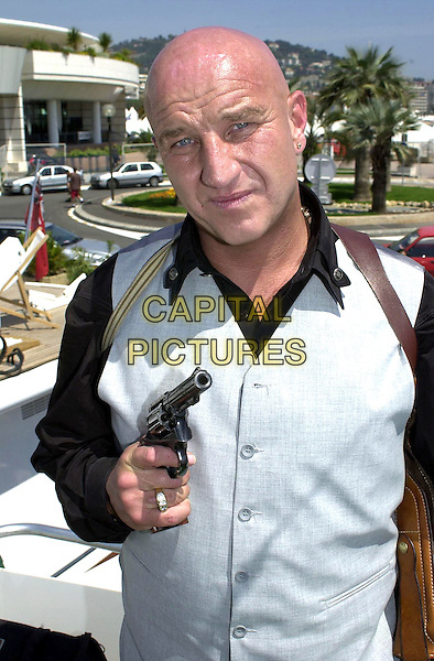 DAVE COURTNEY.Former London gangster who is in Cannes to promote two films in which he stars,.Cannes Film Festival, France, 13th May 2001..half length gun.Ref: PL.www.capitalpictures.com.sales@capitalpictures.com.©Capital Pictures.