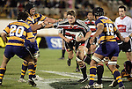 Bay defenders swarm in on Kristian Ormsby as he makes one of his telling runs during the Air NZ Cup rugby game between Bay of Plenty & Counties Manukau played at Blue Chip Stadium, Mt Maunganui on 16th of September, 2006. Bay of Plenty won 38 - 11.