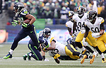 Seattle Seahawks running back Thomas Rawls (34) runs though the tackle of Pittsburgh Steelers safety Mike Mitchell (23) at CenturyLink Field in Seattle, Washington on November 29, 2015.  The Seahawks beat the Steelers 39-30.      ©2015. Jim Bryant Photo. All Rights Reserved.