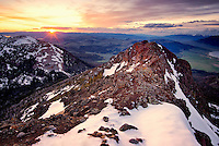 The setting sun illuminates Sawtell Peak along the Continental Divide which forms the boarder between Idaho and Montana.