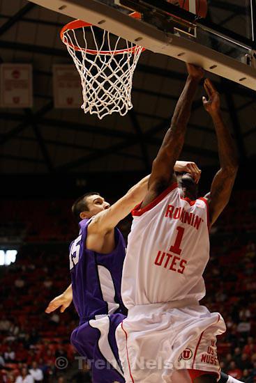 Trent Nelson  |  The Salt Lake Tribune.Utah's Jay Watkins (1) is fouled by TCU's Zvonko Buljan. University of Utah vs. TCU mens college basketball, Saturday, January 9, 2010.