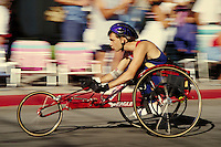 Male in adapted wheelchair competing in race event, Mount Shasta, CA. Racing. Safety helmet. Mount Shasta California.