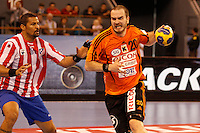 25.03.2012 MADRID, SPAIN -  EHF Champions League match played between BM At. Madrid vs Kadetten Schaffhausen (26-30) at Palacio Vistalegre stadium. the picture show  Didier Dinart (BM Atletico de Madrid) and Rares Jurca (Kadetten Schaffhausen player)
