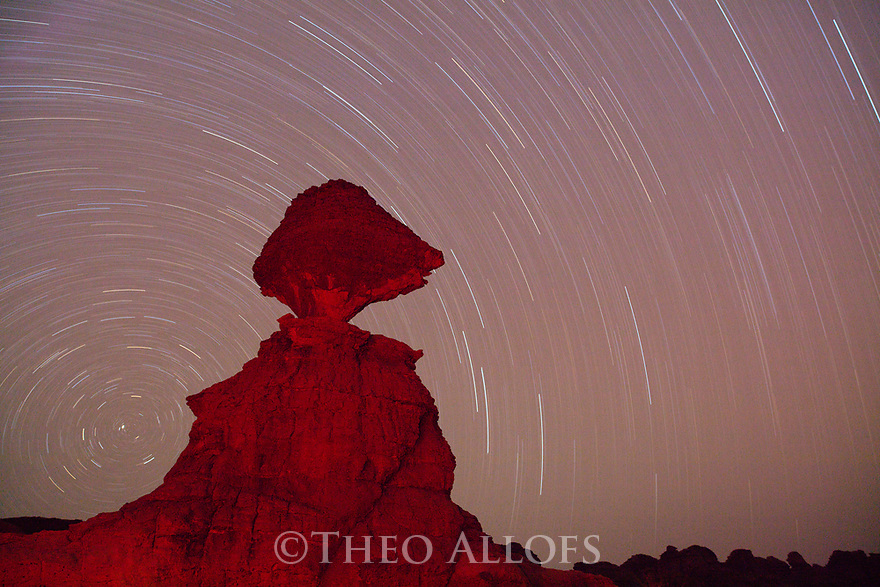 Chad (Tchad), North Africa, Sahara, Ennedi, bizarre rock formation at night with star trails, long exposure