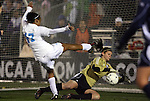 04 December 2009: Notre Dame's Nikki Weiss (in gold) makes a save on North Carolina's Jessica McDonald (47). The University of North Carolina Tar Heels defeated the Notre Dame University Fighting Irish 1-0 at the Aggie Soccer Complex in College Station, Texas in an NCAA Division I Women's College Cup Semifinal game.